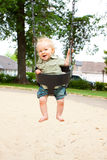 Child on Swings Stock Images