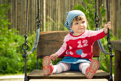 Child on the swings Stock Images