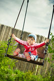 Child on the swings royalty free stock image