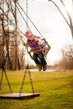 Child swings on seesaw Stock Photography