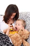 Child and syrup Stock Image