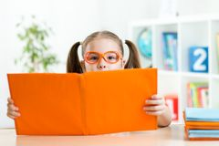 Child at the table with books Stock Photography