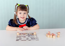 Child at table played with bingo Stock Images