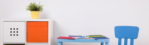 Child table set and shelving Stock Photo