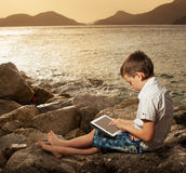 Child with tablet computer Stock Image