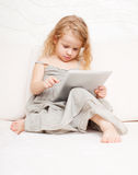 Child with tablet Royalty Free Stock Image