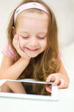 Child with tablet computer Royalty Free Stock Images
