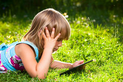 Child with a tablet computer outdoor Royalty Free Stock Photography