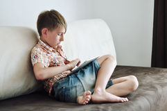 Child with tablet computer Stock Photos