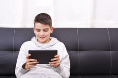 Child with tablet Royalty Free Stock Photos