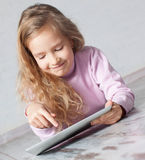 Child with tablet pc Royalty Free Stock Photography