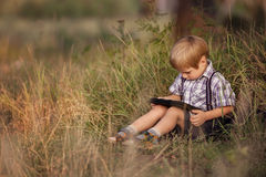 Child with tablet pc outdoors. Stock Images