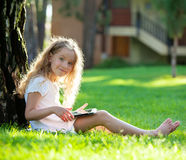 Child with tablet pc outdoors Royalty Free Stock Images