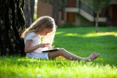 Child with tablet pc outdoors at summer Stock Photos