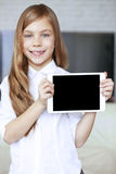 Child with tablet pc Royalty Free Stock Image
