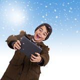 Child with tablet Stock Images