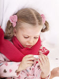Child take temperature by thermometer. Stock Photography