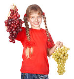 Child takes bunch of grape. Stock Photos
