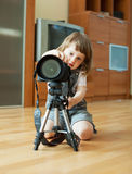 Child takes photo with tripod Stock Images