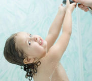 Child takes a shower Royalty Free Stock Photography