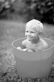 Child taking bath outdoors Stock Photography