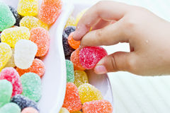 Child Taking Candy Stock Images