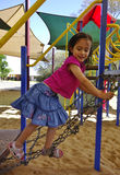 Child Taking Care on Play Equipment. Royalty Free Stock Photography
