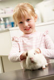Child Taking Guinea Pig To Veterinary Surgery royalty free stock photos