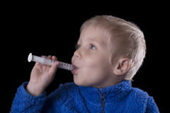 Child taking medicine Stock Photos