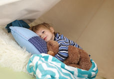 Child Taking a Nap, Resting in a Play Tent Stock Photo