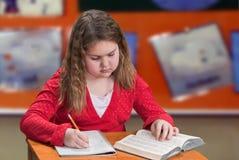 Child Taking Notes Royalty Free Stock Photos