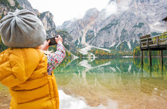 Child taking photo of lake braies in south tyrol Royalty Free Stock Images