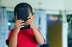 child taking picture with mobile phone camera Royalty Free Stock Photos
