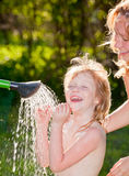 Child taking a shower outdoors Royalty Free Stock Images