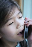 Child talking on cell phone Stock Photo