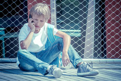 Child talking on cell phone outdoors Stock Photo
