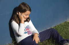 Child talking on mobile phone stock photos