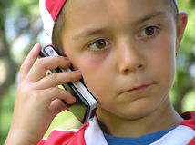 Child talking in mobile phone. Bad news royalty free stock photos