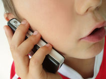 Child talking in mobile phone Royalty Free Stock Photo