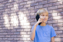 Child talking on mobile phone. People, technology and communication concept. Royalty Free Stock Images