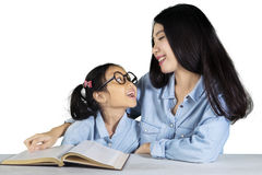 Child talking with mother while studying Stock Photography