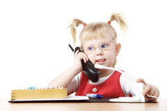 Child talking by phone Stock Photo
