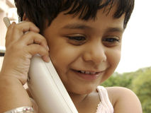 Child talking on phone Royalty Free Stock Photography