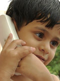 Child talking on phone Stock Images