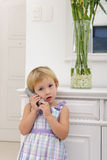 Child talking on phone at home royalty free stock photo