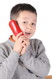 Child is talking with telephone Stock Photo