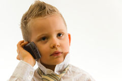 Child talking via cellphone Stock Photos