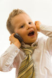Child Talking Via Cellphone Royalty Free Stock Images
