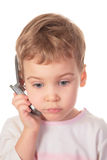 Child talks on cell phone Stock Image