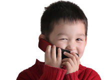 Child talks with cellphone Royalty Free Stock Photos